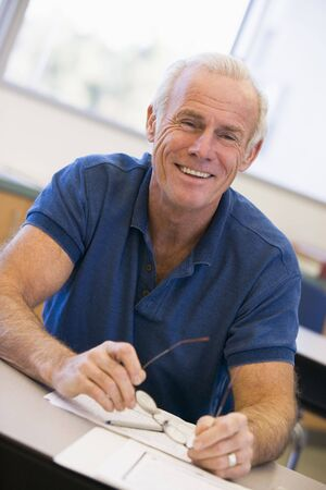 frontal views: Adult student in class smiling Stock Photo