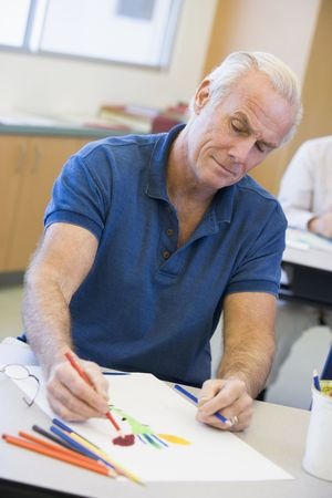 male senior adult: Adult student in class drawing picture Stock Photo