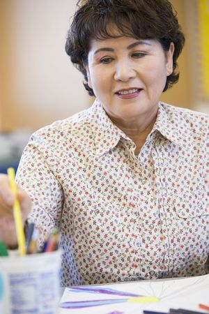 Adult student in class drawing picture (selective focus) Stock Photo - 3194586
