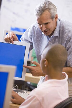 Teacher with male student in computer class Stock Photo - 3201456