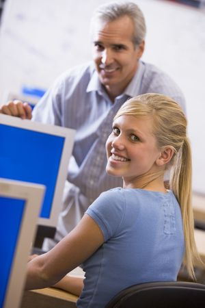 mentors: Teacher with female student in computer class Stock Photo