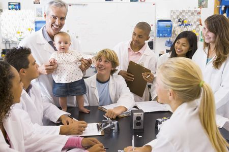 Students in biology class with teacher photo