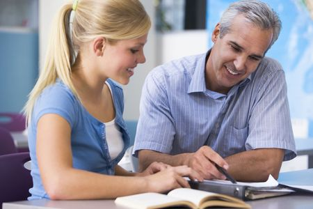 Teacher giving personal instruction to female student Stock Photo - 3201154