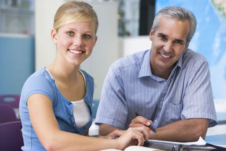 Teacher giving personal instruction to female student Stock Photo - 3207643