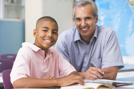 Teacher giving personal instruction to male student Stock Photo - 3205294