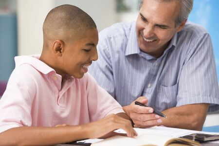 tutoring: Teacher giving personal instruction to male student