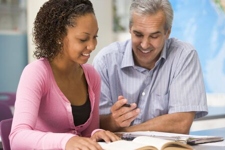tutoring: Teacher giving personal instruction to female student