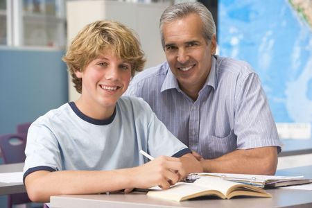tuition: Teacher giving personal instruction to male student