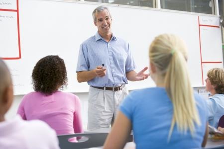 secondary school teacher: Students in math class with teacher