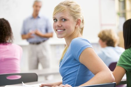 mature student: Female student with other students in classroom Stock Photo