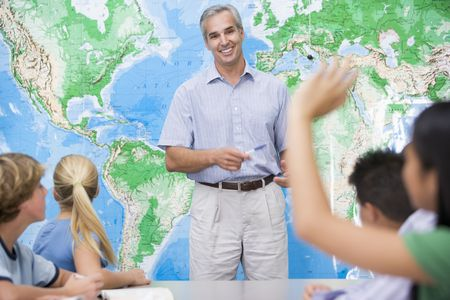 Students answering questions in geography class photo