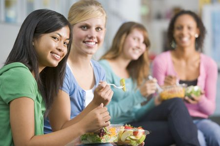 only teenage girls: Students having lunch