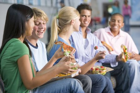 early teens: Students having lunch