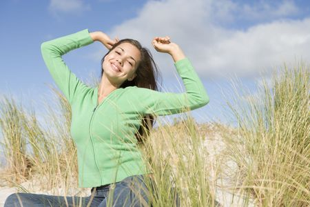 Young woman posing on a sand hill photo