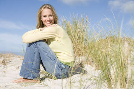 blond streaks: Young woman posing on a sand hill