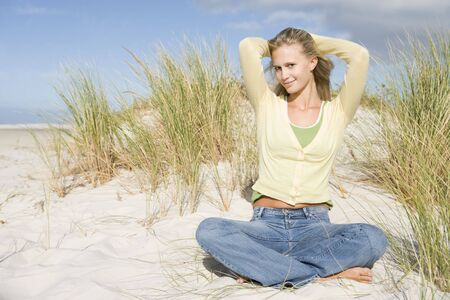 trousers: Young woman posing on a sand hill