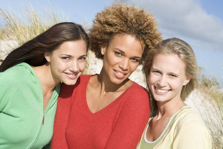 Three women posing outdoors photo