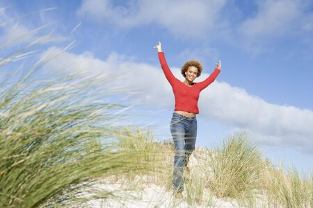 girls at the beach series: Young woman posing on a sand hill