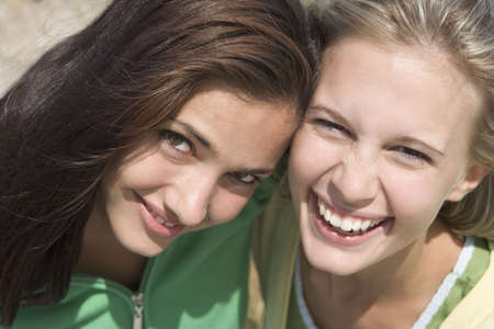 only teenage girls: Two young women posing outdoors