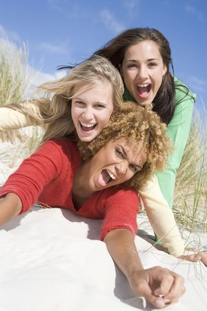 30s thirties: Three women posing on a sand hill