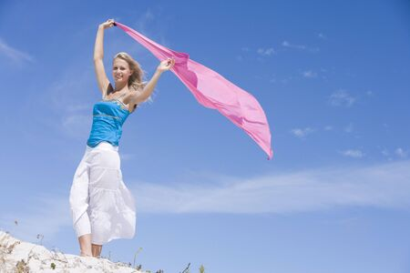 Young woman posing with a scarf on a beach Stock Photo - 3204642
