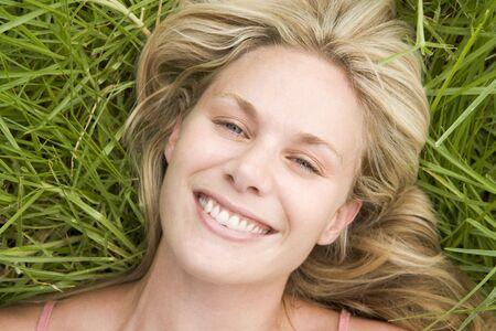 blond streaks: Woman lying on grass