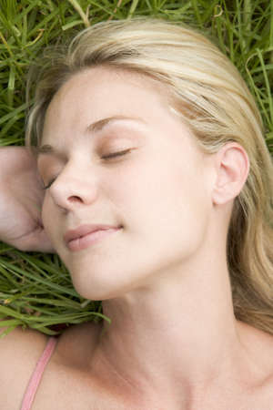 blond streaks: Woman lying on grass