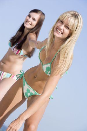 two piece swimsuits: Two women in two piece bathing suits Stock Photo