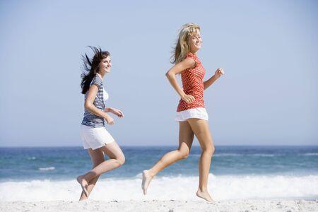 Women jogging on a beach Stock Photo - 3204639