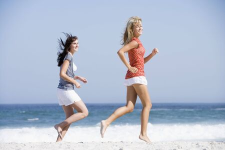 blond streaks: Women jogging on a beach