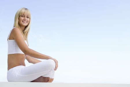Woman sitting and meditating outdoors Stock Photo - 3204609