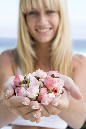 Woman holding a handful of roses photo