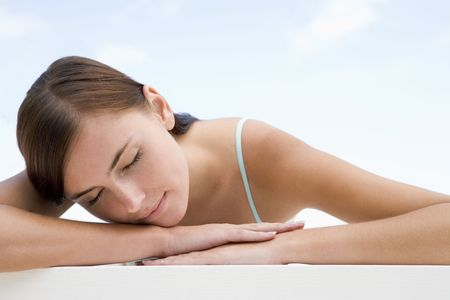 girls at the beach series: Woman posing outdoors with eyes closed Stock Photo
