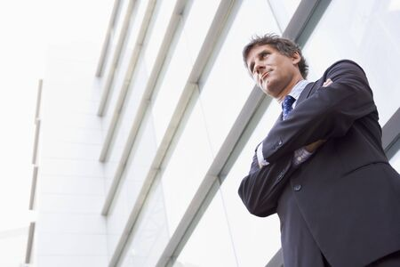offset view: Businessman standing outdoors by building Stock Photo