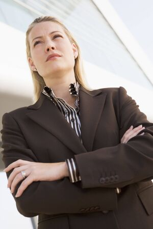 offset angle: Businesswoman standing outdoors by building