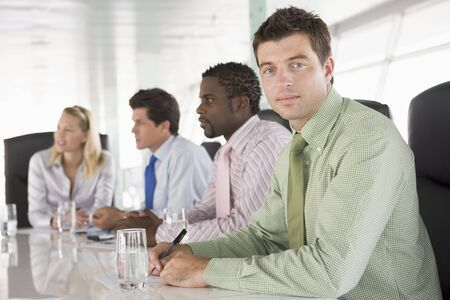 Four businesspeople in a boardroom Stock Photo - 3460290