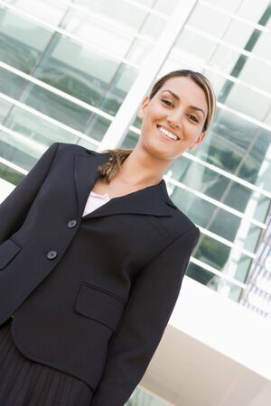 Businesswoman standing outdoors smiling photo