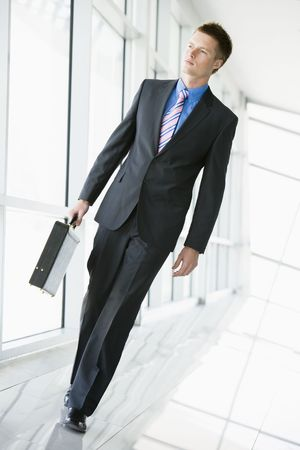 offset angle: Businessman walking in corridor
