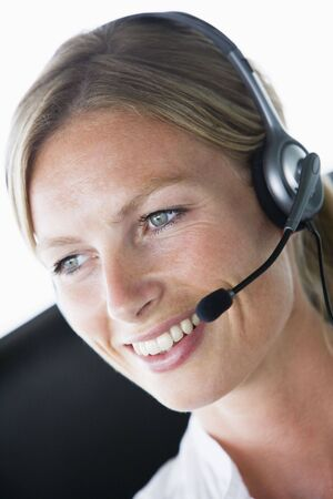 Businesswoman in office wearing headset and smiling photo
