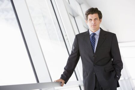 early 40s: Businessman standing in corridor Stock Photo