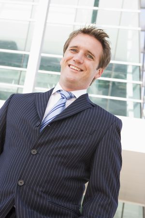 Businessman standing outdoors smiling photo