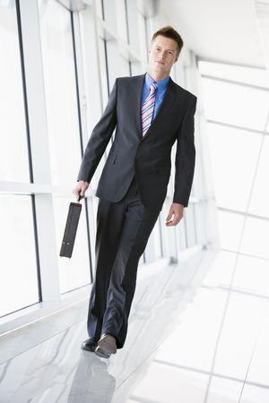 Businessman walking in corridor photo