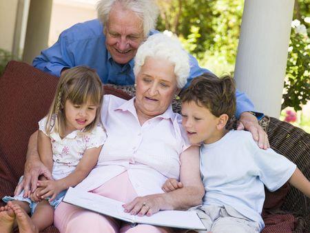 Grandparents reading to grandchildren. photo