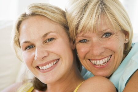 30s adult: Mother and grown up daughter smiling