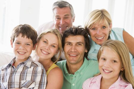 early thirties: Family indoors together smiling