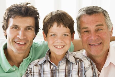 grandfather and grandson: Grandfather with son and grandson smiling.