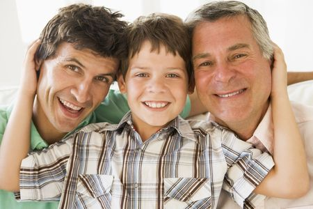multi generation: Grandfather with son and grandson smiling.