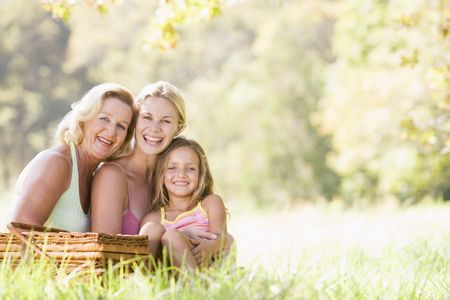 grandmother grandchild: Grandmother with adult daughter and grandchild on picnic Stock Photo