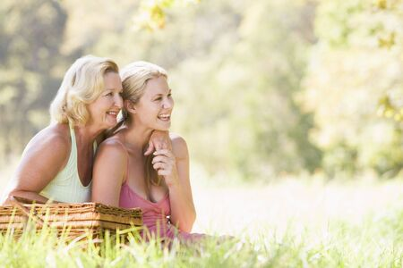 countryside loving: Mother with adult daughter on picnic Stock Photo