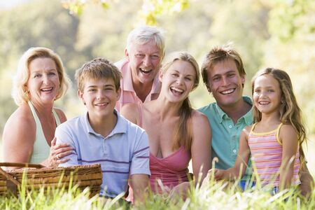 Family at a picnic smiling photo
